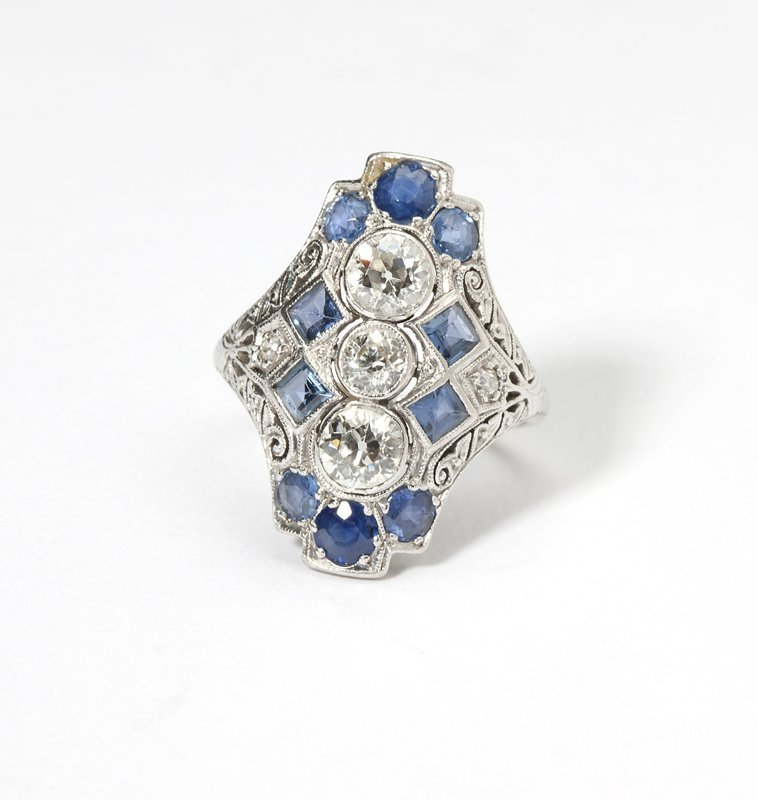 1118: An Art Deco diamond, sapphire and platinum ring