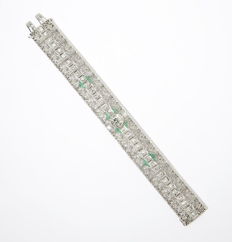 1119: An Art Deco diamond and emerald bracelet