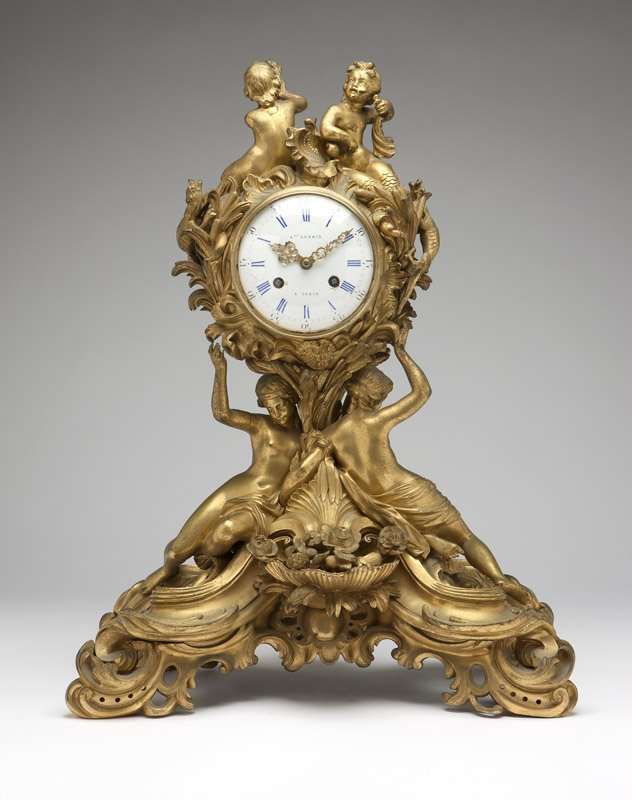1001: A Louis XV style ormolu figural mantle clock