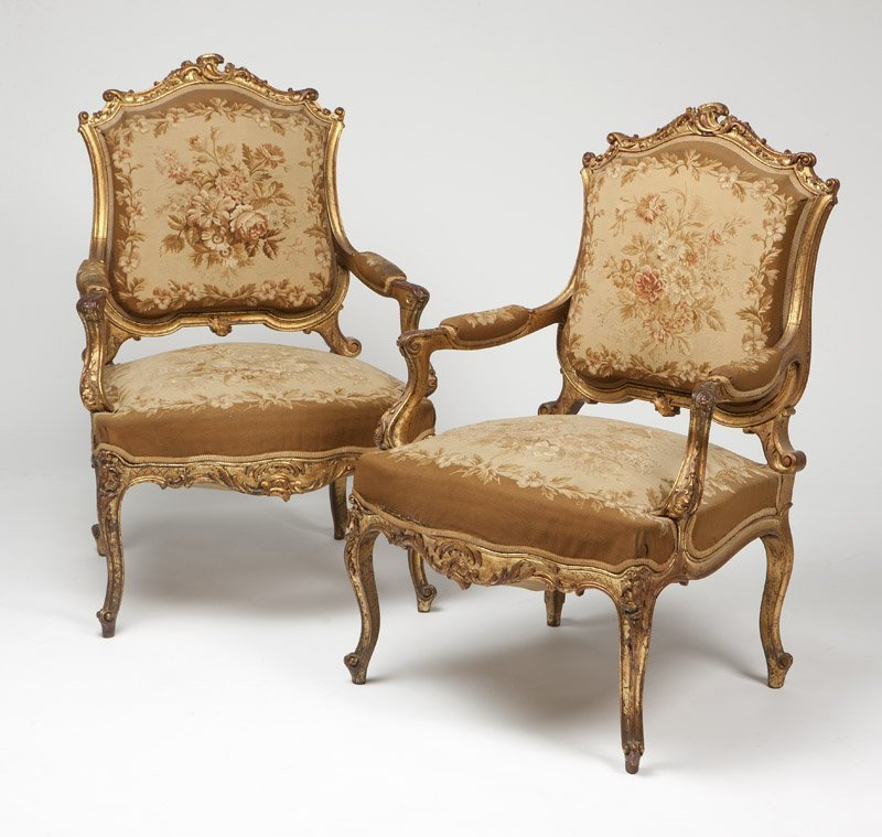 1013: A pair of Louis XV style giltwood fauteuils