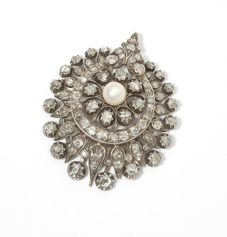 1: An antique diamond and pearl pendant