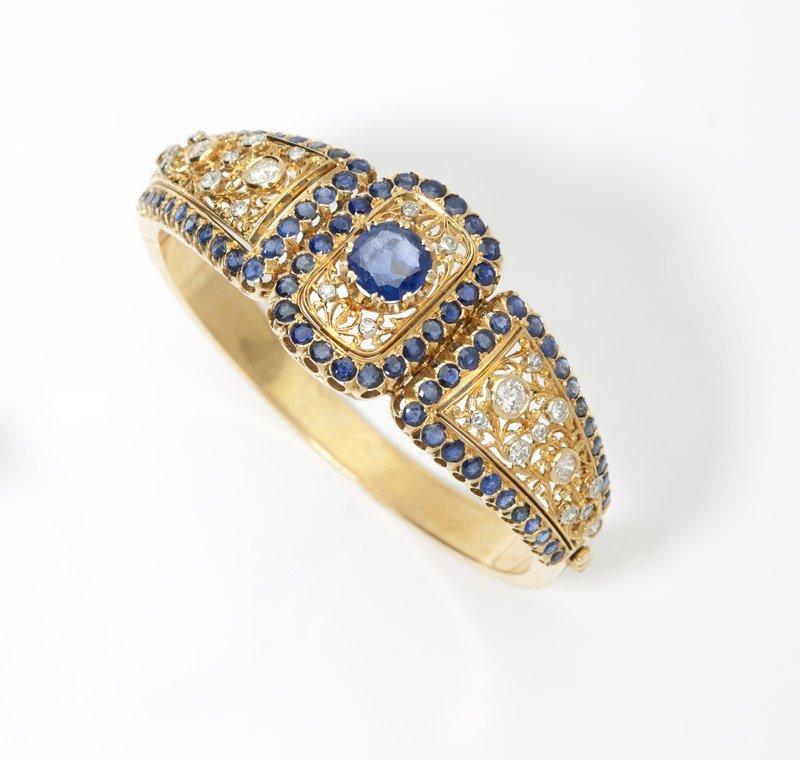 7: A sapphire, diamond and gold bangle