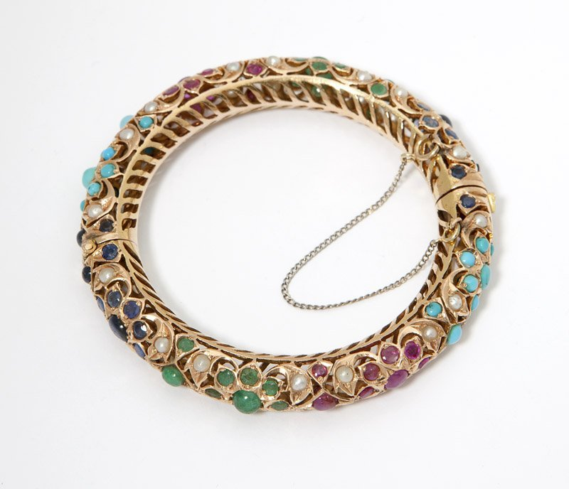 9: An Indian gemset and gold hinged bangle
