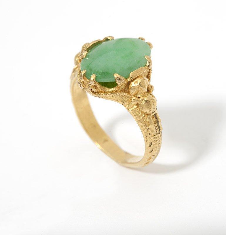 10: A jade cabochon and gold ring