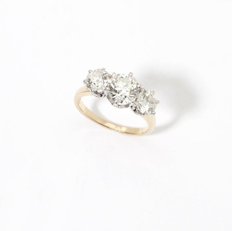 11: A three stone diamond ring