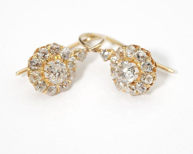 14: A pair of diamond floret earrings