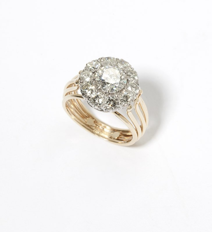 17: A diamond and platinum-topped gold ring
