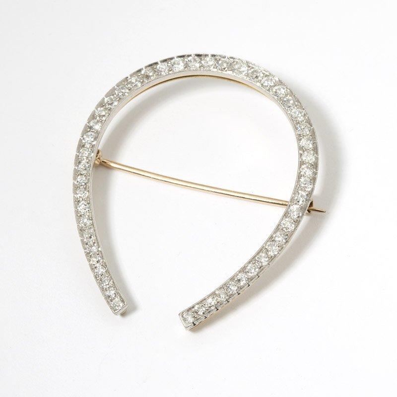 19: A diamond horseshoe brooch