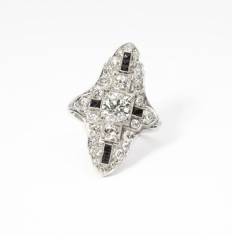 24: An Art Deco diamond, onyx and platinum ring
