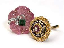 173 A collection of two carved gem diamond and gold r