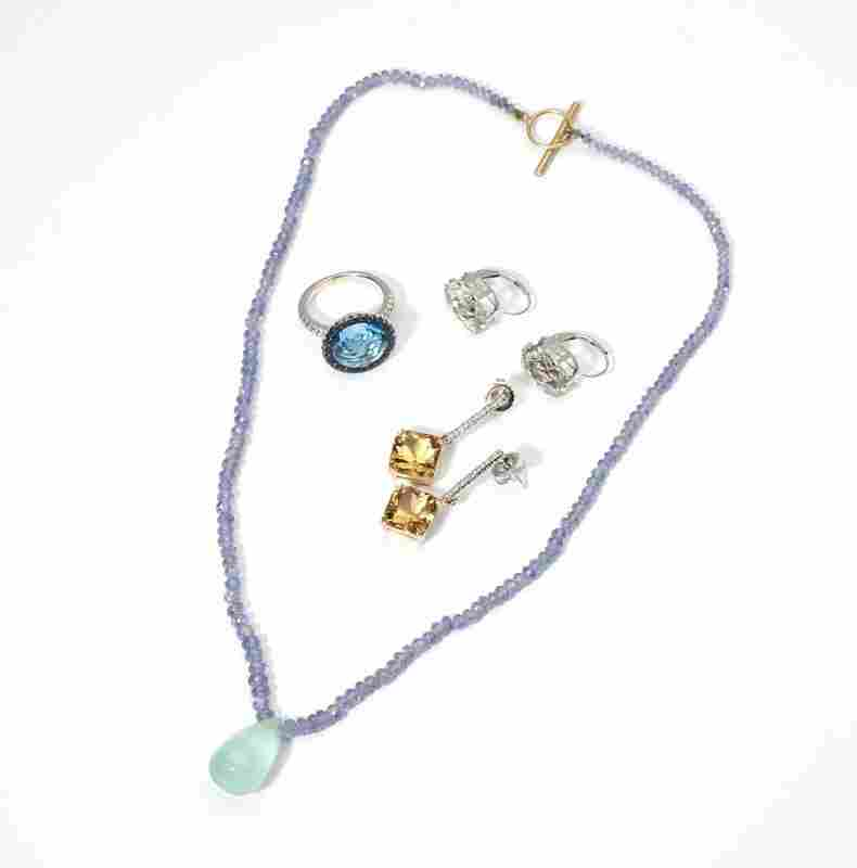 229: A collection of gem-set and gold jewelry;
