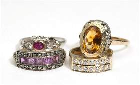 231 A collection of four gem and diamond rings