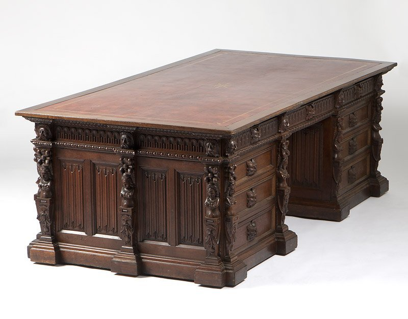 A Renaissance Revival carved oak partner's desk