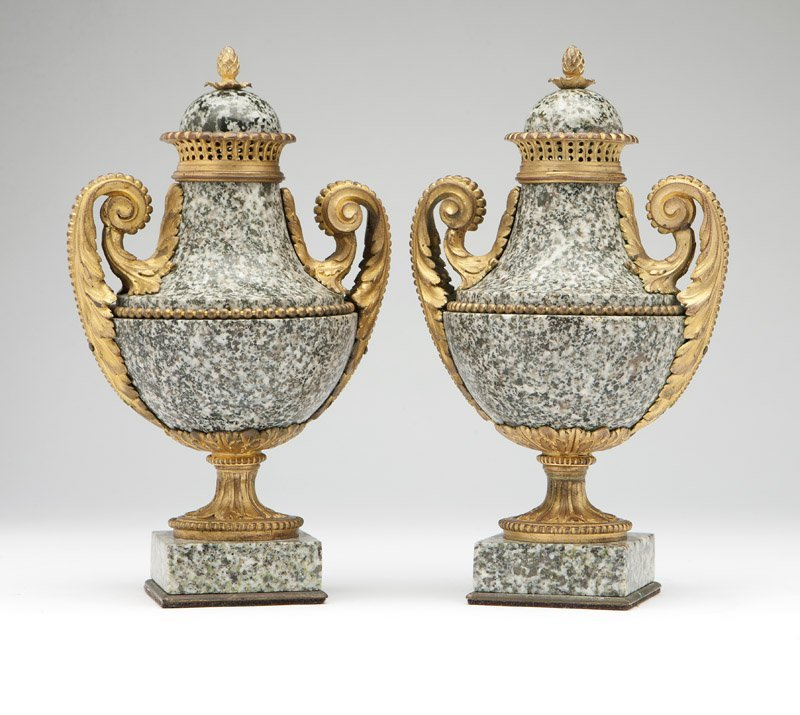 A pair of gilt-bronze-mounted grey-granite urns
