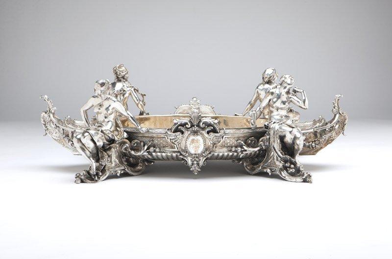 A monumental silvered-bronze figural centerpiece