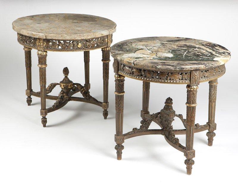 Two Louis XVI style parcel-gilt gueridons