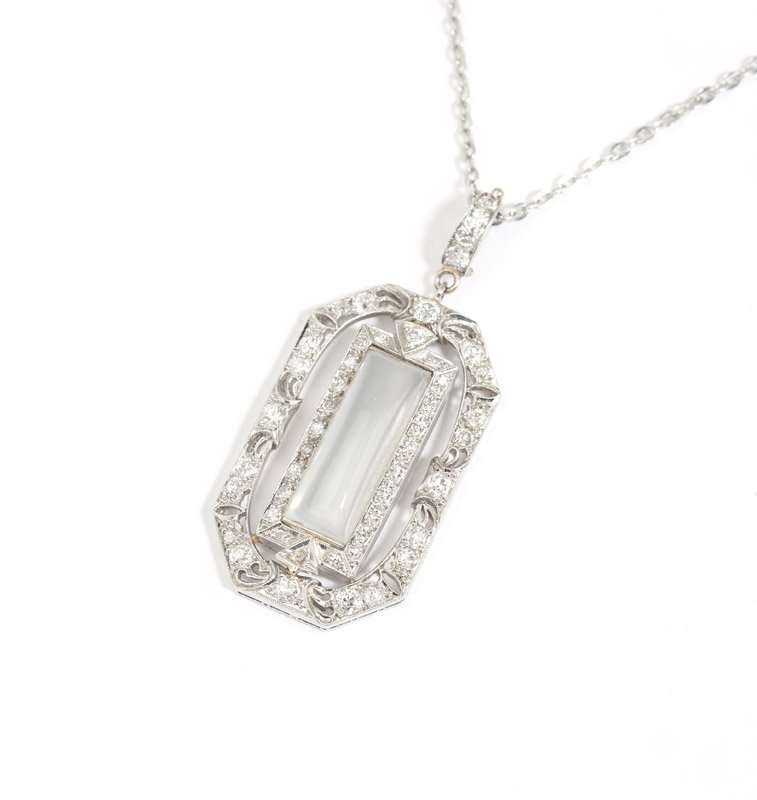 An Art Deco moonstone and diamond pendant