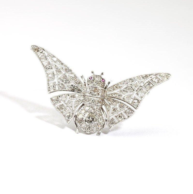 A diamond and platinum moth brooch