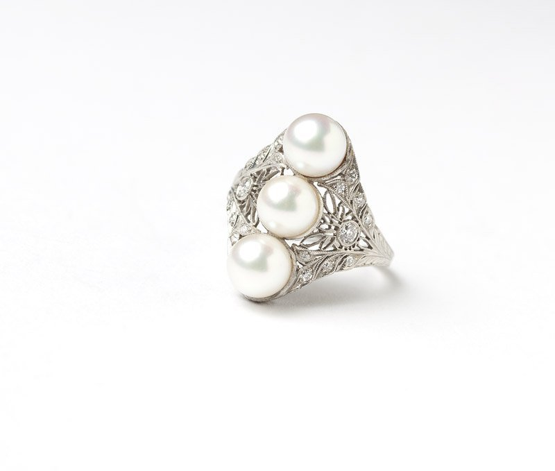 A cultured pearl and platinum ring, Brock & Co