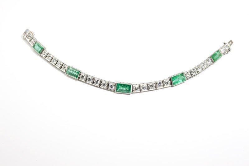 An Art Deco emerald and diamond line bracelet