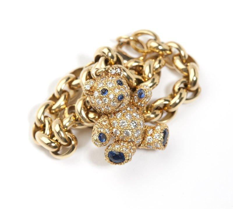 A diamond and gold teddy bear charm bracelet - 2