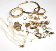 A collection of gold and gold filled jewelry