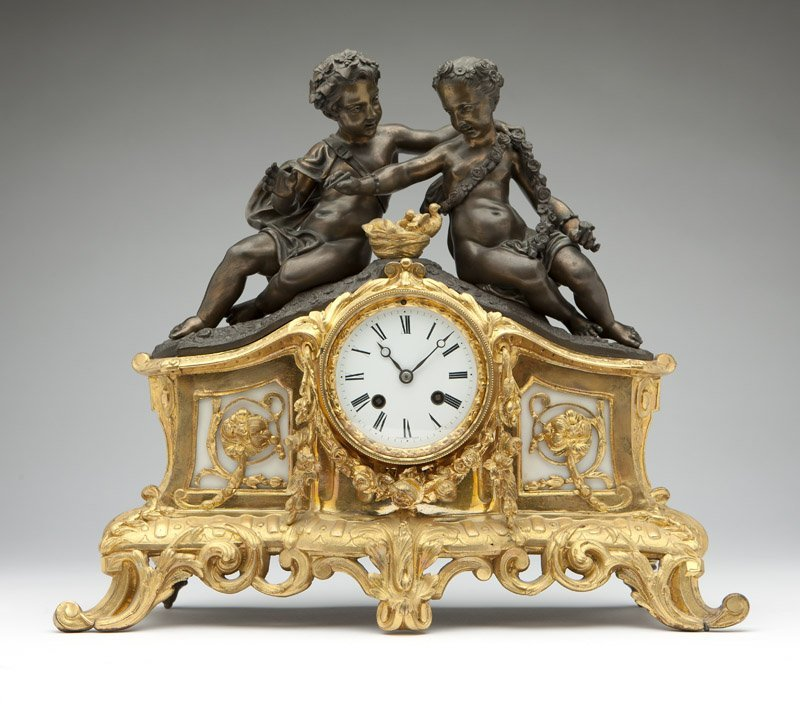 A gilt & patinated bronze mantel clock, Bolviller