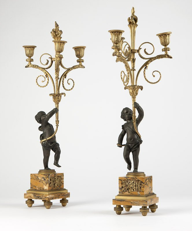 A pair of gilt & patinated bronze candelabra