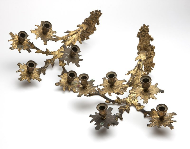 A pair of Rococo style gilt bronze wall sconces