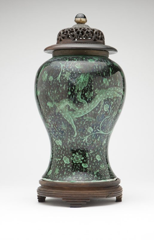 A Chinese green & mirror black porcelain vase