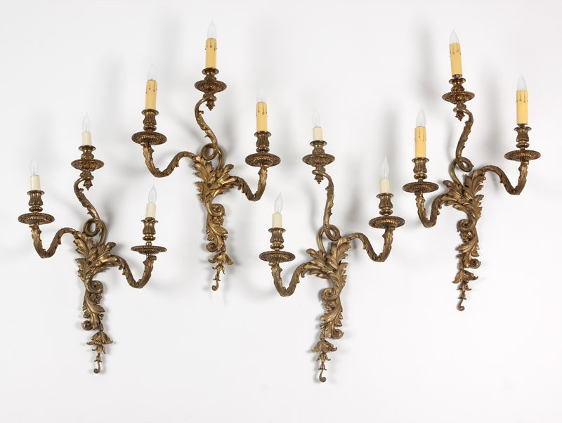 Four Louis XV style gilt bronze wall lights