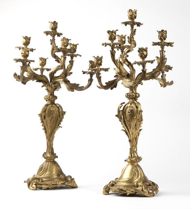 A pair of Louis XV gilt bronze candelabra