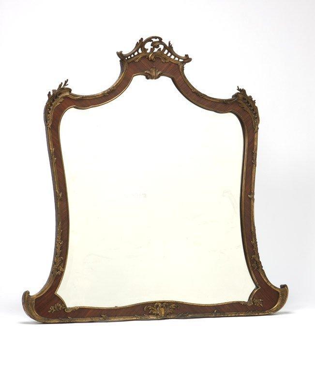 A Louis XV style gilt bronze-mounted mirror