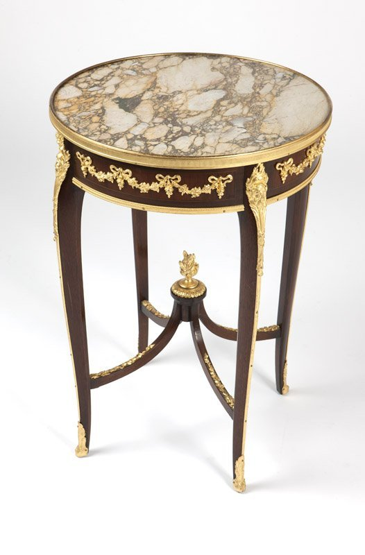A Louis XV style gilt bronze-mounted table