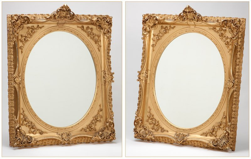 A pair of Continental gilt wood mirrors
