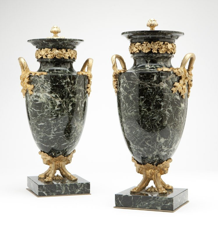 A pair of marble & gilt bronze urns