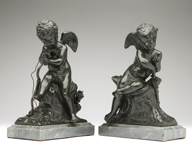 A pair of patinated bronze models of Cupid