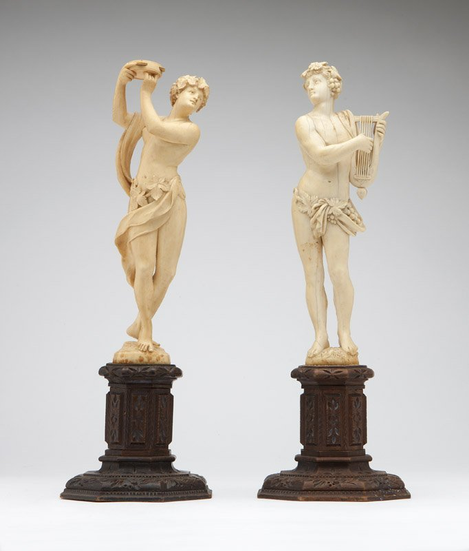 A pair of Continental carved ivory statues