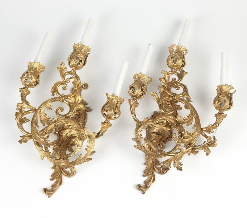 A pair Louis XV style gilt bronze wall lights