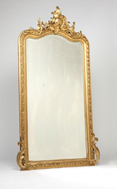 A large Rococo style carved giltwood mirror