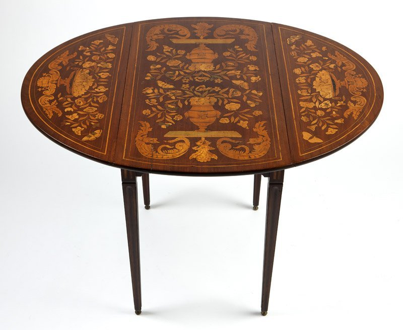 A Continental marquetry drop-leaf table