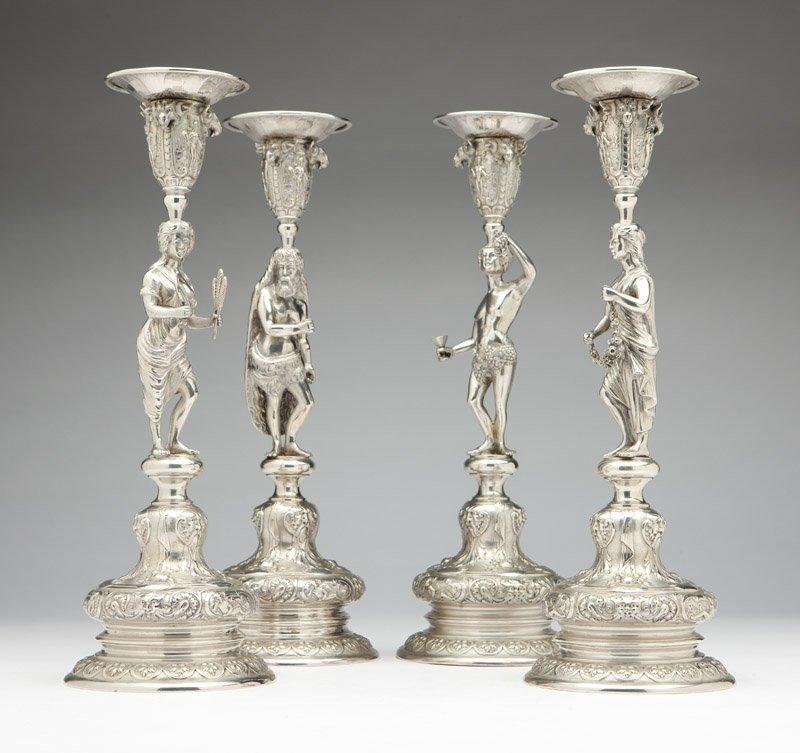 Four German .800 silver figural candlesticks