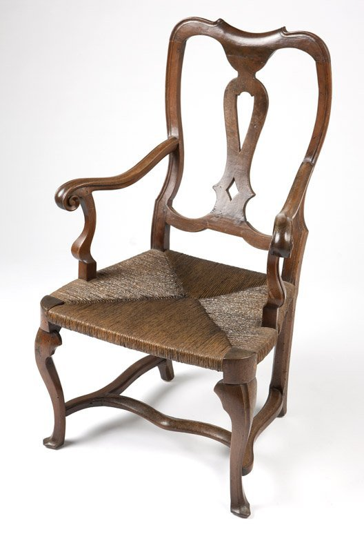 A Continental carved walnut armchair
