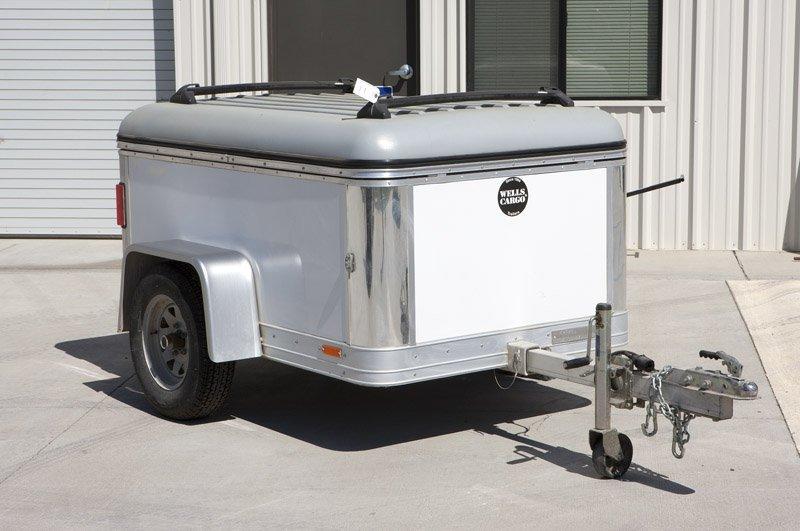 A 2007 Wells Cargo multipurpose aluminum trailer