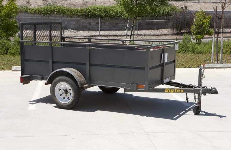 A 2002 Big Tex open-top cargo trailer
