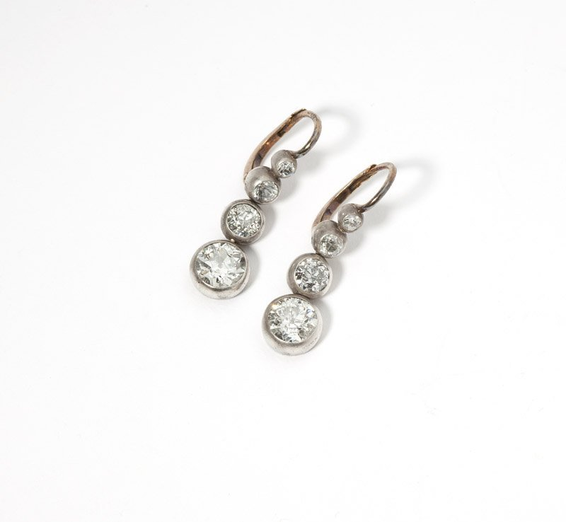 A pair of antique silver-topped diamond earrings