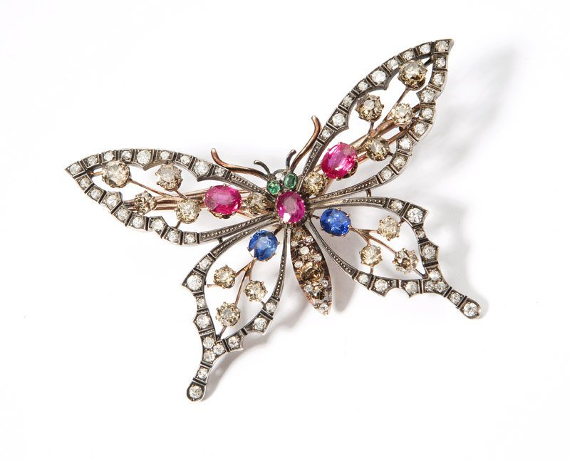 A gem, diamond and silver-topped butterfly brooch