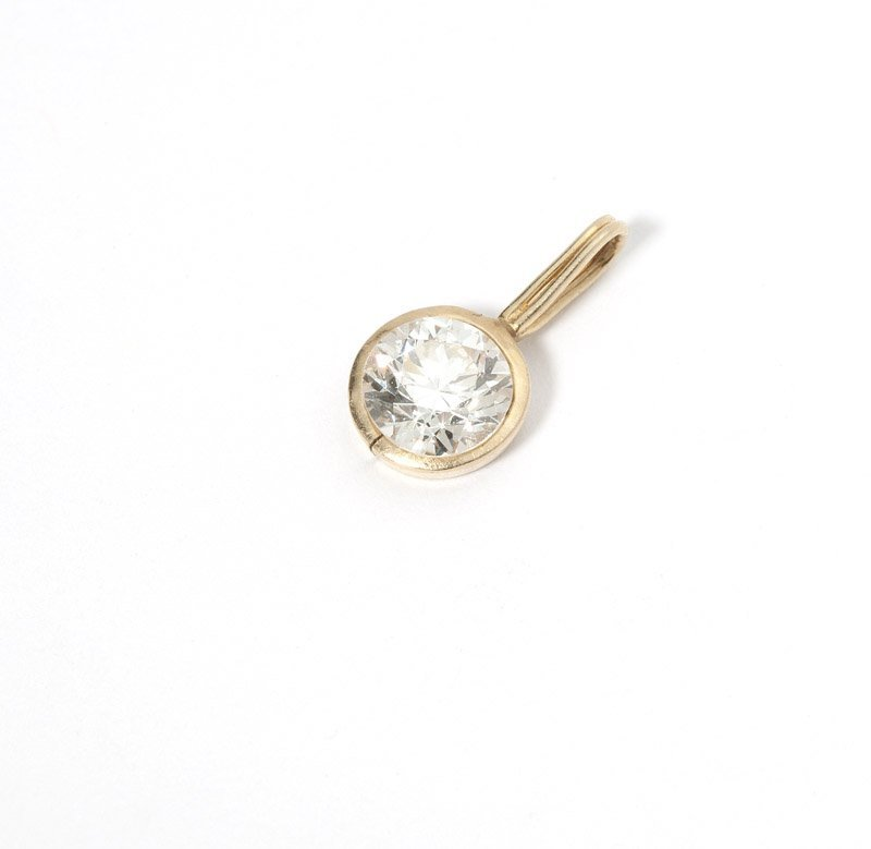 A diamond and gold pendant