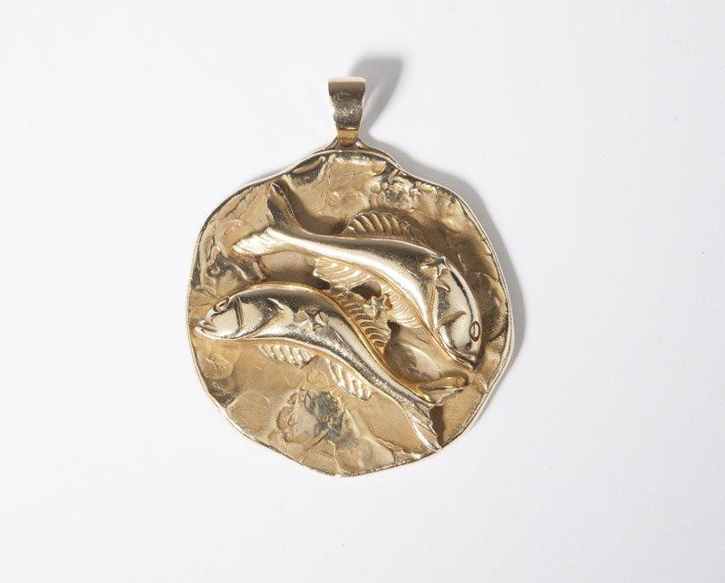 An M.Hime gold pisces pendant