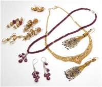 A collection of Indian gem and gold jewelry